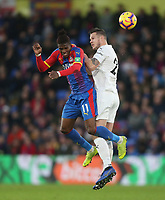 Crystal Palace's Wilfried Zaha and Burnley's Kevin Long<br /> <br /> Photographer Rob Newell/CameraSport<br /> <br /> The Premier League - Saturday 1st December 2018 - Crystal Palace v Burnley - Selhurst Park - London<br /> <br /> World Copyright &copy; 2018 CameraSport. All rights reserved. 43 Linden Ave. Countesthorpe. Leicester. England. LE8 5PG - Tel: +44 (0) 116 277 4147 - admin@camerasport.com - www.camerasport.com
