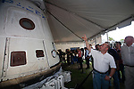 Garrett Reisman of SpaceX discusses the the Dragon capsule with members of the press on July 6, 2011 at the company's launch control center at Cape Canaverale, Florida. The Dragon capsule was the launched into orbit by SpaceX in 2011.
