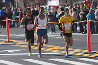 NEW YORK - NOVEMBER 7: Abdelkabir Saji (224) of Italy, Bado Worku Merdessa (200) of the USA, and Jorge Real (228) of the USA, approach the 8 mile mark on 4th avenue in the 2010 New York City Marathon.