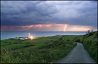 BNPS.co.uk (01202 558833)<br /> Pic: IslandVisions/BNPS<br /> <br /> ***Must use full byline***<br /> <br /> Lightning over St Catherines Lighthouse, Niton on the Isle of Wight, captured by photographer Jamie Russell (36) from Shanklin, Isle of Wight.<br /> <br /> The dramatic weather conditions formed as warm air clashed with a cold front moving in over the country.