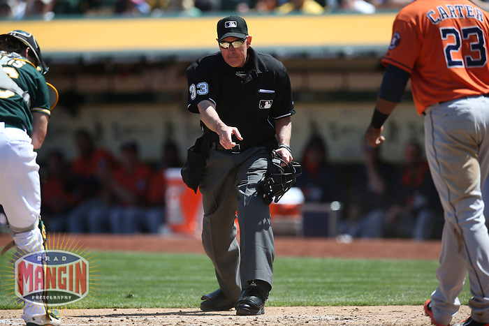 OAKLAND, CA - APRIL 19:  Umpire Mike Winters works during the game between the Houston Astros and Oakland Athletics at O.co Coliseum on Saturday, April 19, 2014 in Oakland, California. Photo by Brad Mangin