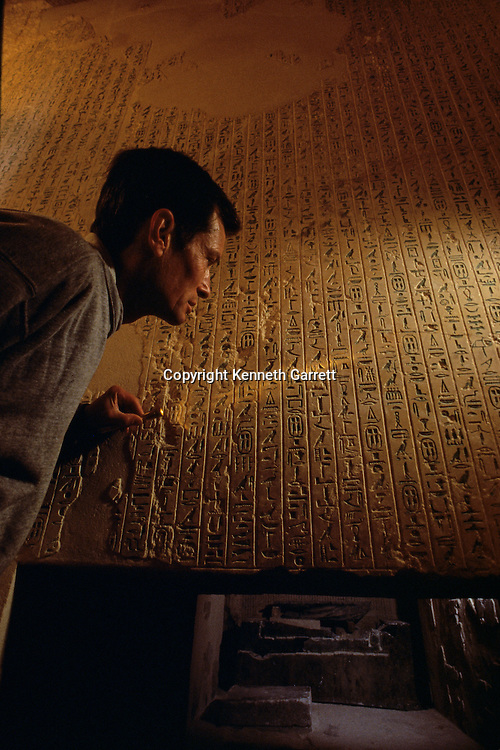 Egypt of the Pharaohs, French Egyptologist, Audran Labrousse, studies pyramid texts at entrance to King Pepi's burial chamber