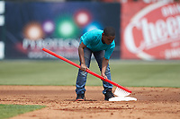A young fan cleans second base with a giant toothbrush between innings of the South Atlantic League game between the Lexington Legends and the Kannapolis Intimidators at Kannapolis Intimidators Stadium on May 15, 2019 in Kannapolis, North Carolina. The Legends defeated the Intimidators 4-2. (Brian Westerholt/Four Seam Images)