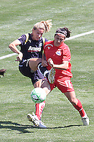 Ali Wagner #4 of the Los Angeles Sol looks to control a loose ball against Lisa De Vanna #17 of the Washington Freedom during their WPS game at The Home Depot Center on June 7,2009 in Carson, California.  The Sol defeated the Freedom 3-1.