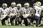 Lawndale, CA 10/01/10 - Mickey O'crowley (Peninsula #53), Walt Proenca (Peninsula #56), Blake Allman (Peninsula #77), Joey Augello (Peninsula #58) and Haden Gregory (Peninsula #42) in action during the Peninsula-Lawndale Varsity football game.