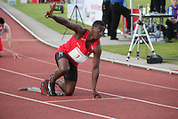 Tuesday 15th July 2014<br /> Pictured: Christian Malcolm <br /> RE: Christian Malcolm, holds his relay baton in the air  while kneeling in the starting block about to compete in the Welsh Athletics International 4x100m relay at Cardiff International Sports Stadium, South Wales, UK. His last race on home soil.