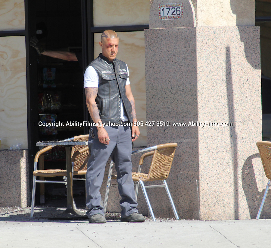June 10th 2013<br /> <br /> <br /> Charlie Hunnam , Kim Coates, Tommy Flanagan and Theo Rossi riding his motorcycle filming the tv show Sons of Anarchy in Los Angeles. Theo had a bloody beat up face. <br /> <br /> AbilityFilms@yahoo.com<br /> 805 427 3519 <br /> www.AbilityFilms.com