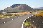 Road leading to cone of Mount Corona volcano and Ye village, Haria, Lanzarote, Canary Islands, Spain