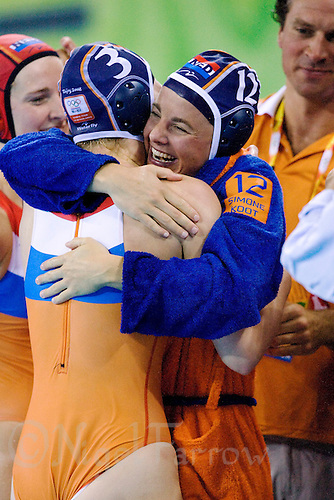 17 AUG 2008 - BEIJING, CHN - Simone Koot (NED) celebrates with Mieke Cabout the Dutch victory over Italy in the quarter final match - Netherlands (blue) v Italy (white) - Beijing Olympics. (PHOTO (C) NIGEL FARROW) *** IOC RULES APPLY ON USAGE ***