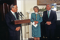 Taoiseach (Prime Minister) Albert Reynolds of Ireland makes remarks during the ceremony where he will present United States President Bill Clinton with a bowl of shamrocks honoring St. Patrick's Day with in the Roosevelt Room of the White House in Washington, DC on March 17, 1993. During his remarks, President Clinton announced he was naming Jean Kennedy Smith as US Ambassador to Ireland.  From left to right: Prime Minister Reynolds, Jean Kennedy Smith, and US Senator Ted Kennedy (Democrat of Massachusetts)<br /> Credit: Martin H. Simon / Pool via CNP/AdMedia