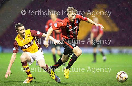Motherwell v St Johnstone.....01.01.14   SPFL<br /> David Wotherspoon skips a tackle from Stephen McManus<br /> Picture by Graeme Hart.<br /> Copyright Perthshire Picture Agency<br /> Tel: 01738 623350  Mobile: 07990 594431
