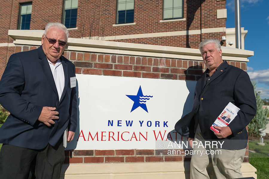 """Merrick, New York, USA. October 23, 2016. L-R, JOHN E. BROOKS, Democratic Party candidate for New York State Assembly District 14, and MIKE REID, Democratic Party Candidate for New York Legislature, attend environmental and civic groups' rally to demand public water and protest New York American Water's (""""NYAW"""") proposal to raise residents' water bills by 9.90%. Rally was held outside the New York American Water Headquarters."""