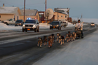 Steve Watkins runs down Front Street on his way to the finish line in Nome on Saturday March 21, 2015 during Iditarod 2015.  <br /> <br /> (C) Jeff Schultz/SchultzPhoto.com - ALL RIGHTS RESERVED<br />  DUPLICATION  PROHIBITED  WITHOUT  PERMISSION