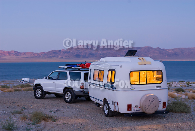 Casita travel trailer camping at the shore of Walker Lake.