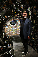 Artist Olafur Eliasson with his Your spiral view sculpture, 2002 at Olafur Eliasson, In real life exhibition. Sixteen years since his sun installation The weather project dazzled over 2 million visitors in Tate Modern's Turbine Hall, Danish-Icelandic artist presents the biggest survey of his career so far, In real life, a showcase of new immersive installations, an unmissable survey spanning over 30 years of Eliasson's career, at Tate Modern, London England on July 09, 2019.<br /> CAP/JOR<br /> ©JOR/Capital Pictures