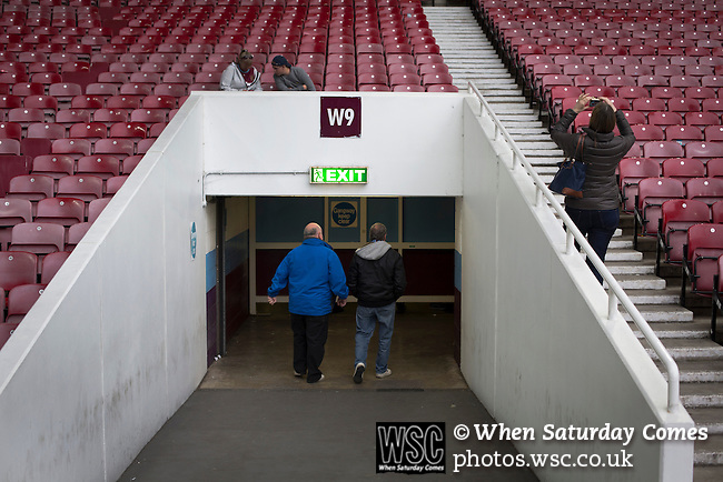West Ham United 2 Crystal Palace 2, 02/04/2016. Boleyn Ground, Premier League. Home fans in the Betway Stand leaving the ground at the end of the match at the Boleyn Ground as West Ham United hosted Crystal Palace in a Barclays Premier League match. The Boleyn Ground at Upton Park was the club's home ground from 1904 until the end of the 2015-16 season when they moved into the Olympic Stadium, built for the 2012 London games, at nearby Stratford. The match ended in a 2-2 draw, watched by a near-capacity crowd of 34,857. Photo by Colin McPherson.