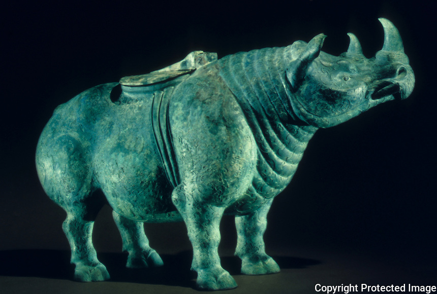 "China:  Rhinoceros container (zun), Eastern Zhou, 475-221 B.C.  13 3/8 "" high bronze.  Historical Museum in Beijing.  The Great Bronze Age of China--exhibition."