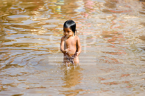 Altamira, Brazil. Kayapo child in the river.
