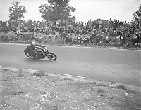 1955; The winner once again and unbeaten at Brands Hatch in three years, John Surtees winning on his Norton motorbike after beating Geoff Duke once again