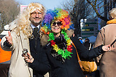Düsseldorf, Germany. 15 February 2015. A couple in fancy dress. Street carnival celebrations take place on Königsallee (Kö) in Düsseldorf ahead of the traditional Shrove Monday parade (Rosenmontagszug).