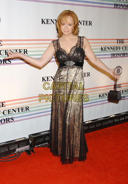 REBA McENTIRE.29th Annual Kennedy Center Honors - Arrivals .held at the John F. Kennedy Center for the .Performing Arts, Washington, D.C. USA,.03 December 2006..full length black lacce dress beige sheer arms bag purse.CAP/ADM/LF.©Laura Farr/Admedia/Capital Pictures