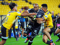 Nehe Milner-Skudder (left) and Ardie Savea wrap up Sibusiso Sithole during the Super Rugby match between the Hurricanes and Sharks at Westpac Stadium, Wellington, New Zealand on Saturday, 9 May 2015. Photo: Dave Lintott / lintottphoto.co.nz