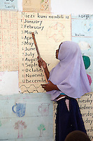 Jambiani, Zanzibar, Tanzania.  School Girl Recites Names of the Months in English.