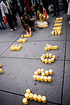 The candles on the pavement, installed by militants from Amnesty International.<br /> <br /> Les bougies installees par les militants d'Amnesty International.