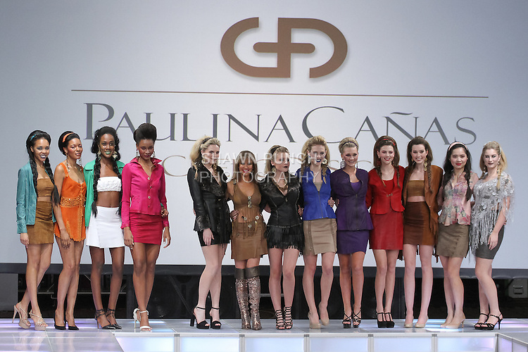 Fashion designer Paulina Cañas walks runway with models for the close of her Cuero Design Fall 2017 collection fashion show, at Crowne Plaza Times Square Manhattan, on February 10, 2017, during Couture Fashion Week Fall 2017.