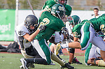 Manhattan Beach, CA 10/24/13 - Paxton Shive (Peninsula #24) and unidentified Mira Costa player(s) in action during the Palos Verdes Peninsula and Mira Costa Junior Varsity Football game at Mira Costa High School.