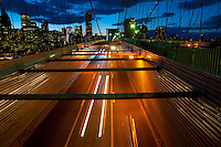 Light trails from busy traffic of Brooklyn bridge and Manhattan slyline