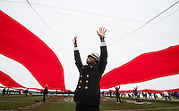 San Francisco, Ca - Saturday, December 29, 2012: A Navy Midshipman holds up a giant USA flag before the start of the Kraft Fight Hunger Bowl. Arizona State 62-28 over Navy.