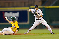 Shortstop Rick Hauge #11 of the Rice Owls throws to first base to complete a double play as Raynor Campbell #6 of the Baylor Bears slides into second base in the 2009 Houston College Classic at Minute Maid Park March 1, 2009 in Houston, TX.  The Owls defeated the Bears 8-3. (Photo by Brian Westerholt / Four Seam Images)