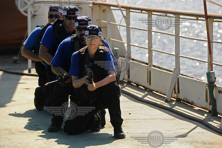 Trainees take part in a training course to fight maritime terror and piracy, on a boat in Haifa Port..