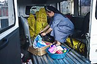 Preparing the boxes with the reliefs that include medicines, rice, noodles, soap, tissues, cookies and cooking materials. Those reliefs are donated by the Benedictine schools of Manila.<br /> <br /> Pr&eacute;paration des bo&icirc;tes avec les secours qui comprennent des m&eacute;dicaments, du riz, des nouilles, du savon, des mouchoirs, des biscuits et du mat&eacute;riel de cuisine. Ces secours sont donn&eacute;s par les &eacute;coles b&eacute;n&eacute;dictines de Manille.