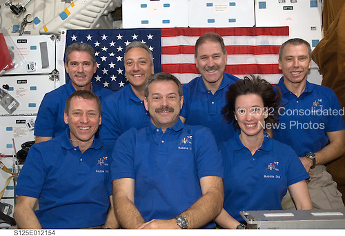 In Earth Orbit - May 20, 2009 -- The crewmembers for the STS-125 mission pose for the traditional in-flight portrait on the middeck of the Earth-orbiting Space Shuttle Atlantis. Pictured on the front row are astronauts Scott Altman (center), commander; Gregory C. Johnson, pilot; and Megan McArthur, mission specialist. Pictured on the back row (left to right) are astronauts Michael Good, Mike Massimino, John Grunsfeld and Andrew Feustel, all mission specialists..Credit: NASA via CNP