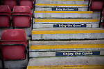 Signs inviting fans to 'enjoy the game' on steps at the Alexandra Stadium on Gresty Road, Crewe, the home of Crewe Alexandra before their home game against Leyton Orient in the SkyBet League One. The match was won by the visitors from London by 2-1 with two goals on debut by Chris Dagnall, sending Orient to the top of the league. The match was watched by 4830 spectators.