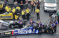 Apr. 15, 2012; Concord, NC, USA: NHRA crew members for top fuel dragster drivers Antron Brown (near lane) and Spencer Massey during the Four Wide Nationals at zMax Dragway. Mandatory Credit: Mark J. Rebilas-