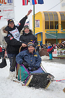 Aaron Peck and team leave the ceremonial start line at 4th Avenue and D street in downtown Anchorage during the 2013 Iditarod race. Photo by Jim R. Kohl/IditarodPhotos.com