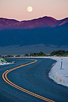 Full moon rising over the Shoshone Mts., SR 722 winds up the Desatoya Mts. of central Nevada, Old U.S. 50.