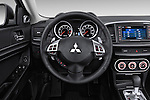 Car pictures of steering wheel view of a 2015 Mitsubishi Lancer  Sportback 5 Door Hatchback