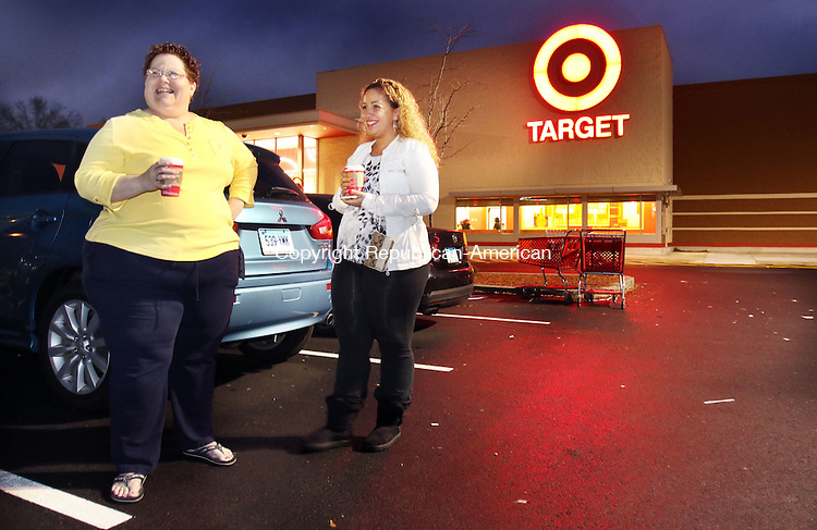 WATERBURY CT. 26 November 2015-112715SV01-Elizabeth Santiago and her daughter Alexa Santiago both of Waterbury take a brief coffee break outside of Target after loading their car with gifts at Target 6:30am in Waterbury Friday. The two started shopping at 3pm Thursday, took a 2-hour nap and continued with their Black Friday shopping. <br /> Steven Valenti Republican-American