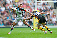Ross Chisholm of Harlequins evades the tackle of Nick Robinson of London Wasps during the Aviva Premiership match between London Wasps and Harlequins at Twickenham on Saturday 1st September 2012 (Photo by Rob Munro).