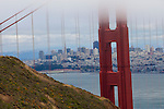 """The Gate Keeper"" The Golden Gate Bridge and Downtown San Francisco, California. The detail is so good in this photograph you can read the name on the side of the Fort Mason Center located at Fisherman's Warf."