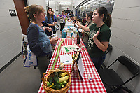 NWA Democrat-Gazette/J.T. WAMPLER Janelle Southan,((CQ)) special education teacher at Elkins High School (LEFT) talks with Jillian Browder of Apple Seeds Teaching Farm Monday August 6, 2018 at the 6th Annual Washington County Education Expo at Elkins High School. Local businesses and organizations were on hand to visit with educators and staff from the Washington County School Districts Elkins, Lincoln, Prairie Grove, Greenland, Farmington, and West Fork.