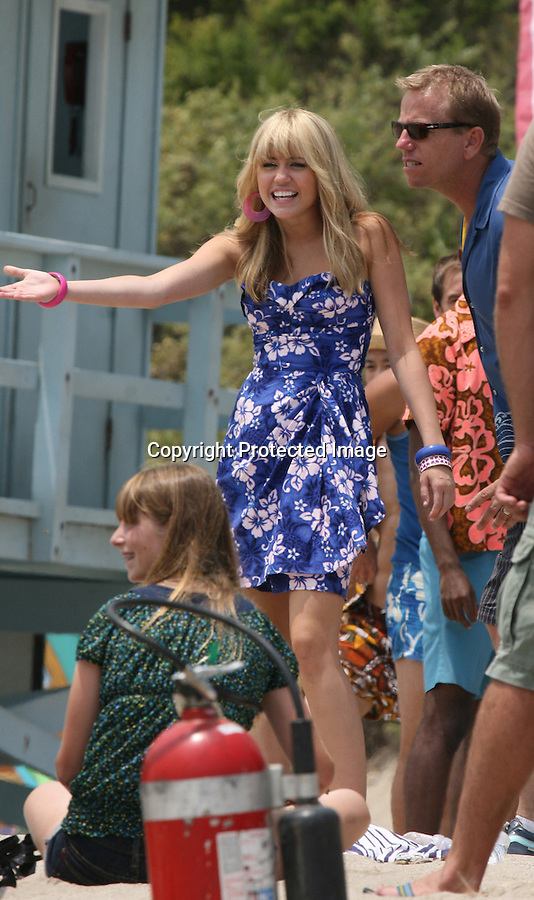 """.July 10th 2008 .Miley Cyrus filming her new movie """"Hana Montana the movie"""" in Malibu California. Miley was up high on a surf board during one of the scenes. .Vanessa Williams was also on set..www.AbilityFilms.com.805-427-3519.AbilityFilms@yahoo.com"""