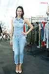 Model poses in Met In Jean outfit at the Coterie 2013 trade show presented by ENK International, at the Javits Center on September 18, 2013.
