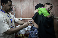 In this Thursday, Aug. 08, 2013 photo, a child receives vaccination at the out patients ward of the field hospital in the sit-in of the Cairo University at Giza district. (Photo/Narciso Contreras).
