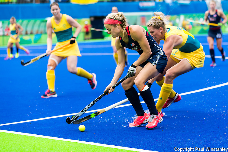 Kathleen Sharkey #24 of United States is closely marked during Australia vs USA in a Pool B game at the Rio 2016 Olympics at the Olympic Hockey Centre in Rio de Janeiro, Brazil.