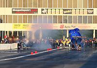 May 18, 2014; Commerce, GA, USA; NHRA top fuel driver Bob Vandergriff Jr (left) loses control alongside Clay Millican during the Southern Nationals at Atlanta Dragway. Mandatory Credit: Mark J. Rebilas-USA TODAY Sports